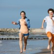 Teenage girl and boy running — Stock Photo #50532409