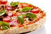 Pizza with pepperoni and tomato — Stock Photo