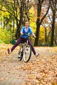 Teenage girl and bike — Stock Photo