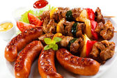 Grilled meat, sausages — Stock Photo