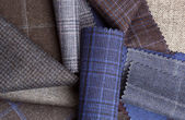 Set of colorful wool fabric textiles to background — Stock Photo