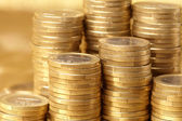 Coins on the gold background — Stock Photo