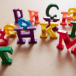 Colore plastic alphabet letters - Stock Photo