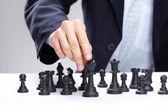 Business man playing chess — Stock Photo