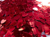 Confetti from little red hearts — Stock Photo