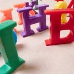 Plastic color alphabet letters — Stock Photo #23161060