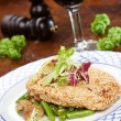 Schnitzel with salad on plate - Stock Photo