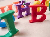 Plastic color alphabet letters — Stock Photo