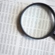 Magnifying glass on the document — Stock Photo