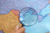 Magnifying Glass on a Map — Stock Photo