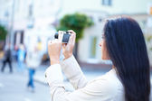Woman with camera — Stock Photo