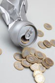 Crushed Aluminum Can with coins — Stock Photo
