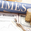 Stock Photo: Financial newspaper with paper
