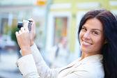 Nice woman making photo — Stock Photo