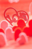 Hearts on red background — Stock Photo