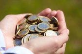 Coins in the hand — Stock Photo