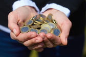 Coins in  hand — Stock Photo