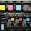 Постер, плакат: CMYK ink cartridges for laser copier machine