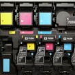 CMYK ink cartridges for laser copier machine - Stock Photo