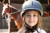 Little girl and brown Horse — Stock Photo