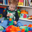 A baby boy playing with plastic blocks — Stock Photo