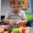 A baby boy crying in children's room — Stock Photo