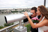 Young wedding couple with tourist binoculars — Stockfoto