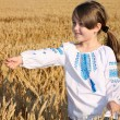 Small rural girl on wheat field — Stock Photo #46239073