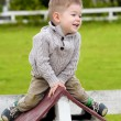 2 years old baby boy sitting on the little rooftop — Stock Photo #46239197