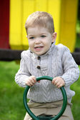 2 years old Baby boy on playground in spring outdoor park  — Stock Photo