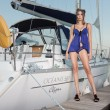 Stock Photo: The charming beauty poses at the yacht