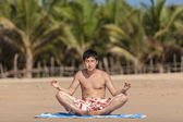Occupations by yoga on a beach — Stock Photo