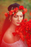 The girl with a bouquet of flowers — Stock Photo