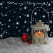 Burning lantern in the snow — Stock Photo