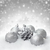 Christmas ball baubles with silver decoration on the snow — Stock Photo