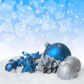 Blue christmas balls on the snow — Stock Photo