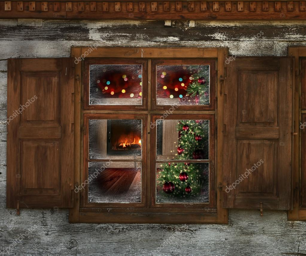 Christmas lights seen through a wooden cabin window for Log cabin window
