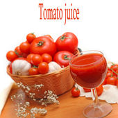 Tomatoes and glass full of fresh tomatoes juice — Stock Photo
