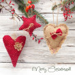 Christmas decorations over wooden background — Stock Photo