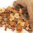 Christmas nuts and spices tumbling from a burlap bag — Stock Photo
