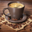 Foto Stock: Cup of coffee on wooden background