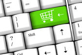 Online shopping eller internet shop koncept, med shopping cart symbol. — Stockfoto
