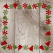 Wooden background with christmas decorations — Stock Photo