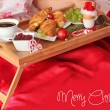 Tray with breakfast on a bed in christmas time — Stock Photo