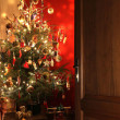 Door opening into a room decorated for Christmas — Stok fotoğraf