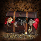 Open wooden treasure chest with valuables — Stock Photo