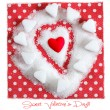 Heart in sugar on red background. Valentines symbol — Stock Photo
