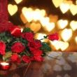 Stock Photo: Valentine background of roses , heart and candle