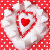 Heart in sugar on red background. Valentines symbol — Foto de Stock