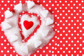 Heart in sugar on red background. Valentines symbol — Stockfoto